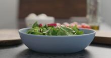 Closeup Making Salad With Mixe...