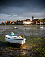 Storm Clouds Over Bosham Quay At Low Tide