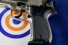 Automatic Pistol And Target On A Blue Background
