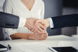 Business people shaking hands finishing contract signing, close-up. Business communication concept. Handshake and marketing