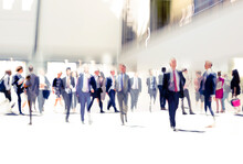 Lots Of Business People Walking In Big Open Space, Transport Station, Airport Etc. Blurred Image, Wide Panoramic View With People At Rush Time. London, UK
