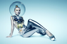 Cyborg Woman Sitting On The Floor In Glass Helmet