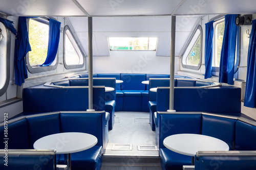 Obraz na plátně Generic passenger ship interior with tables and seats