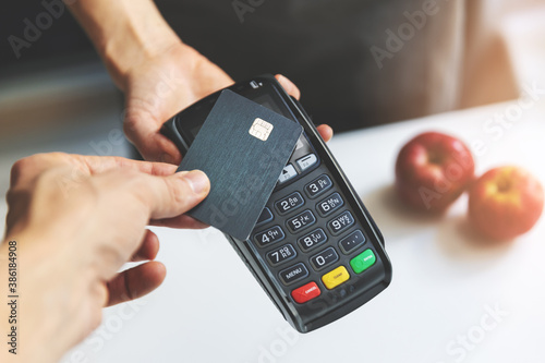 Fotomural nfc contactless payment by credit card and pos terminal