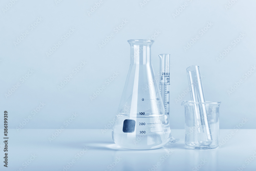 Fototapeta Group of scientific laboratory glassware with clear liquid solution, Science research and development concept.