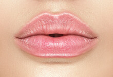 Beautiful Young Woman's Lips Closeup, Part Of The Model Girl Face, Youth Concept. Perfect Healthy Skin. Natural Make-up. Health Care.