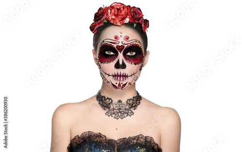 Sugar skull makeup. Halloween party make-up, traditional Mexican carnival, Santa Muerte. Beautiful young woman costume, painted face. Model girl isolated on white background. - 386200930
