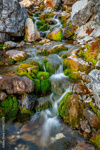 Beautiful little stream forms mini waterfalls as it goes through rocks
