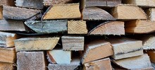 The Ends Of Straight Sawn Boards. Natural Wood Background. High Quality Photo