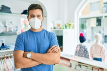 Young Handsome Man Wearing Coronavirus Protection Mask Standing At Clothing Store