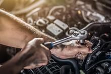 Auto Mechanic Working And Repair On Car Engine In Mechanics Garage. Car Service.