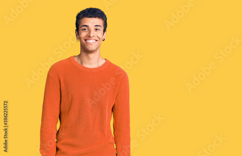 Young african amercian man wearing casual clothes looking positive and happy sta Slika na platnu