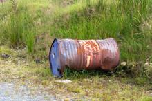 Old Rusty Oil Barrel On Grass