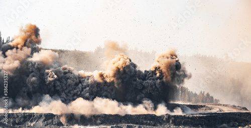 Obraz na plátně Explosive works on open pit coal mine industry with dust and puffs of smoke