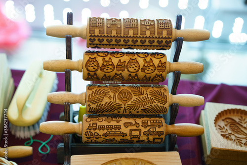 Fototapeta wooden carved rolling pin for cookies obraz