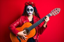 Woman Wearing Day Of The Dead Costume Playing Classical Guitar Skeptic And Nervous, Frowning Upset Because Of Problem. Negative Person.
