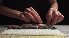 Close-up Of Sushi Chef Hands P...