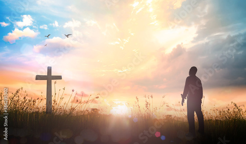 Resurrection of Easter Sunday concept: Silhouette christian over cross meadow su Wallpaper Mural
