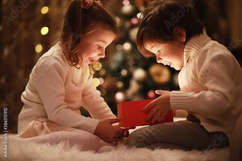 Fotografie, Obraz Family on Christmas eve at fireplace