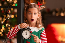 Surprised Little Elf With Alarm Clock At Home On Christmas Eve