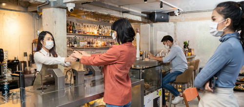 Fototapeta Customer come and order food by social distancing rules of restaurant. obraz