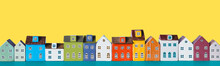 Row Of Wooden Miniature Colorful Retro Houses On A Yellow Background