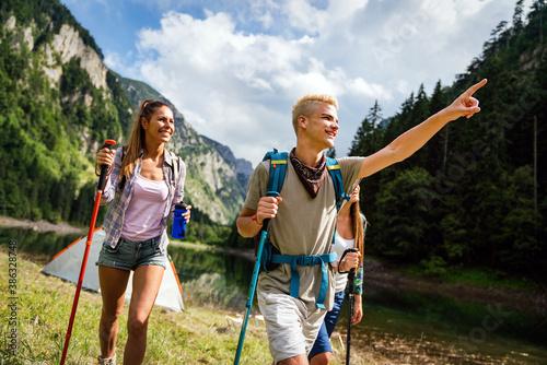 Fototapeta Group of happy friends enjoying outdoor activity together obraz
