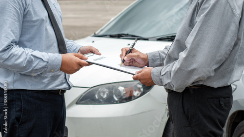 Obraz senior man and insurance agent claim process after car crash. - fototapety do salonu