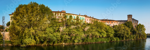 Panoramic view of waterfront homes and historical castle in Cassano d'Adda Italy Wallpaper Mural