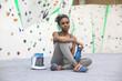 Portrait of female climber taking break holding bottle of water