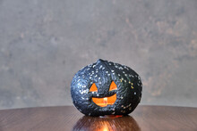 Black Coloured Pumpkin With Gl...