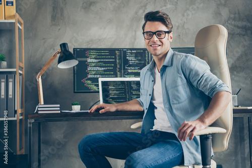 Portrait of positive guy it specialist sit chair desk enjoy working pc home read Canvas