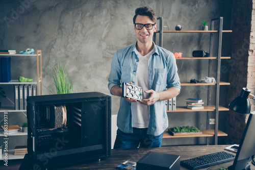 Obraz Portrait of his he nice attractive cheerful cheery confident professional guy geek technician repairing hardware company owner at modern loft industrial home office work place station - fototapety do salonu