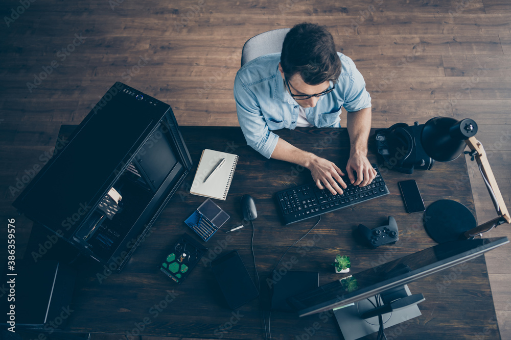 Fototapeta Top above high angle view of his he nice focused guy geek expert specialist typing e-commerce project start-up innovation security data at modern wooden industrial office workplace workstation