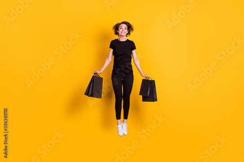 Obraz na płótnie Full length body size view of attractive cheerful funky girl jumping carrying pa
