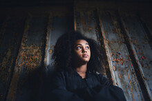 Portrait Of Mixed-race Teenager Girl Standing Indoors In Abandoned Building.
