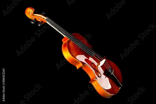Brown wooden fiddle or violin, classic musical instrument, isolated over black b Fototapet