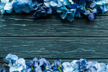 top view of wooden green background with blue floral borders