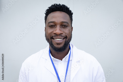 Portrait of male health worker against grey background