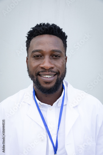 Portrait of male health professional against grey background