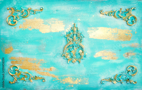 Valokuvatapetti background of blue and gold wooden vintage wall with floral emboss details