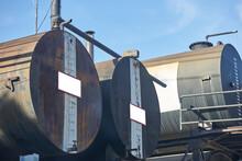 Old Oil Tank On Blue Sky Backg...