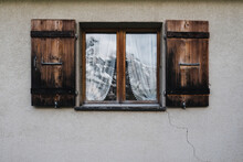 Old Window With Mountain Refle...