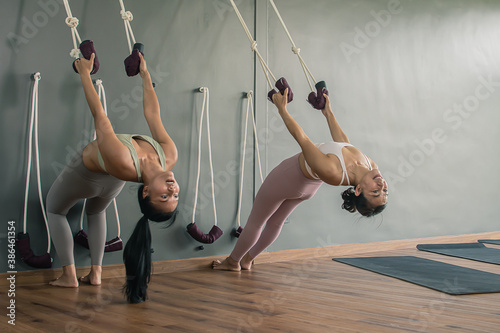 Women doing exercise and stretching in gym Fotobehang