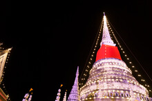 The Image Of An Old Thai Chedi Illuminated By Night