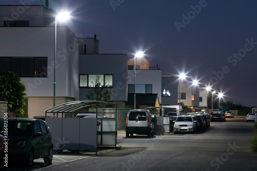 Fotomural modern street with apartment building and led street lights