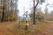 Orthodox Wooden Cross With An Icon On The Road In The Village.