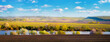 canvas print picture - Panorama, spring landscape with flowering trees by the river and picturesque sky