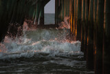Morning waves under the fishing pier