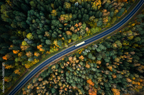 Aerial view of heavy truck on a narrow twisting road #386502382